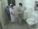 Asian Cleaning Lady Helps Patient In A Toilet