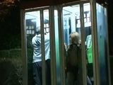 Japanese Woman Abused By Stranger in Phone Booth